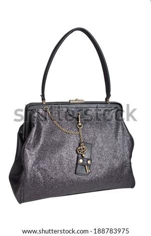 Black female bag with key - stock photo