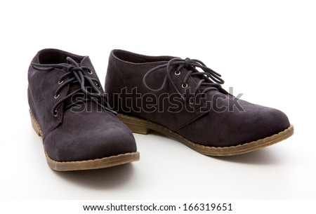 black, female boots on a white background