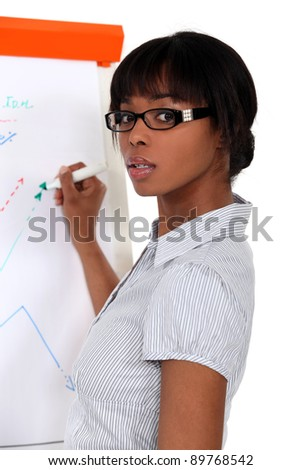black female executive making presentation during meeting - stock photo