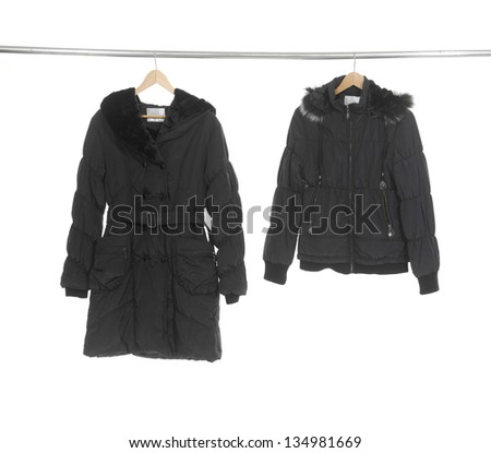 Black female jacket hanging on hanger - stock photo