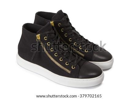 Black female sneakers - stock photo