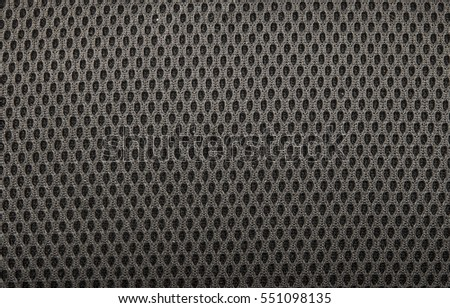black  fishnet cloth material as a texture background