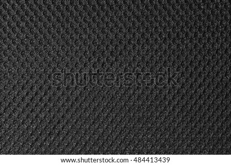 Black fishnet cloth material as a texture background. Nylon texture pattern or nylon background for design with copy space for text or image.