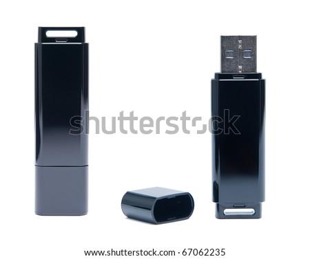 Black flash drive on white background. - stock photo