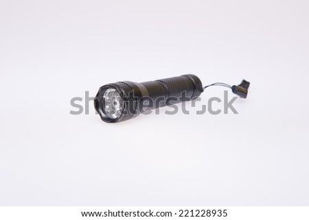 Black flashlight on white background - stock photo