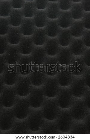 Black foam egg-crate padding is used to protect delicate mechanical and electronic devices and machinery. - stock photo