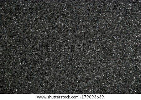 black foam rubber surface - stock photo