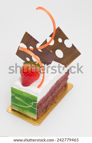 Black forest cake decorated with fresh strawberry and chocolate decorations - stock photo