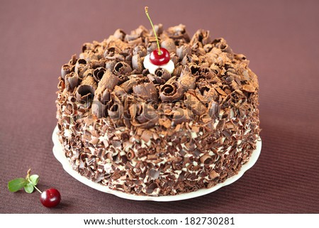Black Forest Cake, on a brown background (horizontal). - stock photo