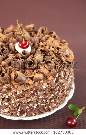 Black Forest Cake, on a brown background (vertical). - stock photo