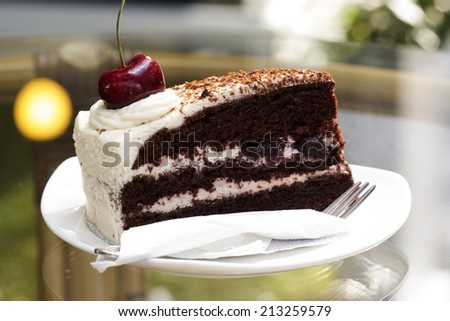 Black Forest Cake on the glass table  - stock photo