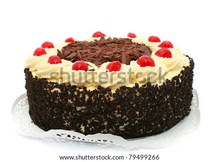 Black forest cake, topped with whipped cream and cherries isolated on white - stock photo