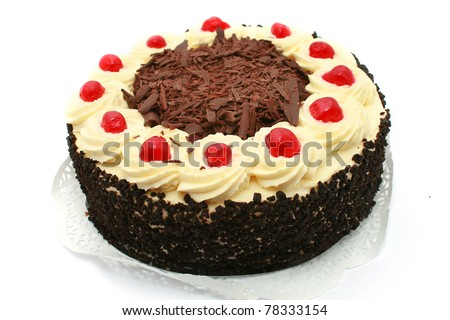 Black forest cake, topped with whipped cream and cherry isolated on white - stock photo