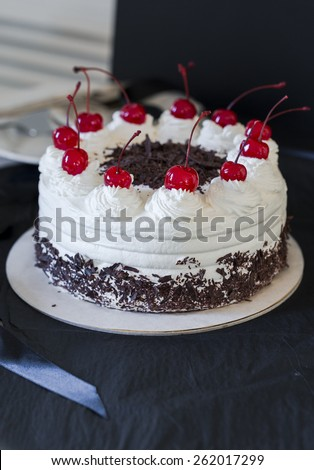 Black Forest cake with maraschino cherries  - stock photo