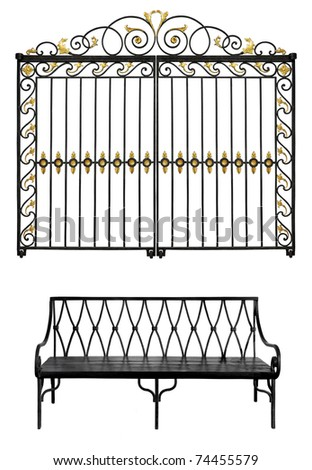 Black forged gate with gold flowers and old bench isolated on white background - stock photo