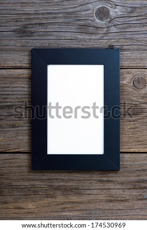 black frame on wood background