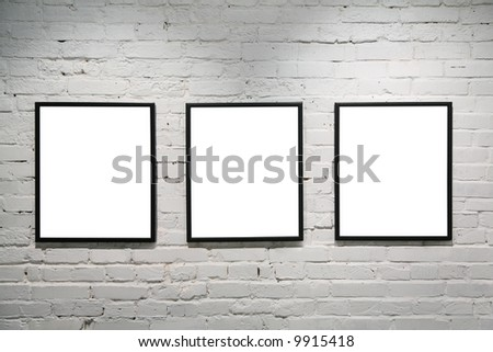 black frames on white brick wall 3 - stock photo