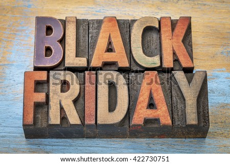 Black Friday banner  in vintage letterpress wood type blocks stained by color inks - stock photo