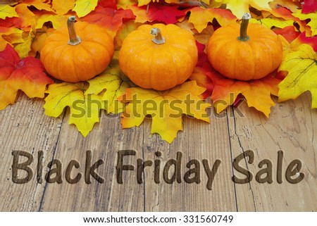 Black Friday Sale, Autumn Leaves on a Weathered Wood Background with text Black Friday Sale - stock photo