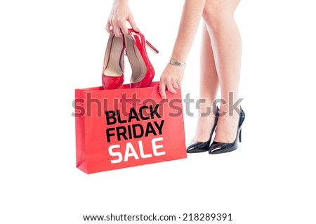 Black Friday sale for woman shoes concept using red shopping bag and high heel female shoes - stock photo