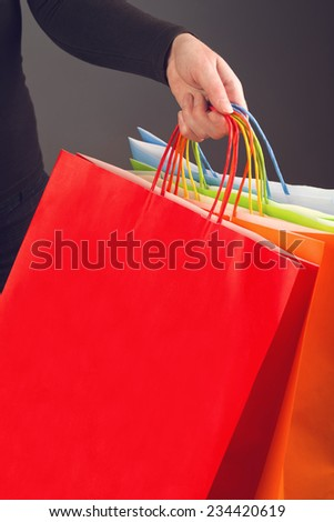 Black friday sale, woman holding colorful shopping bags for discount prices seasonal purchasing event. Sale out and clearance sale concept. - stock photo