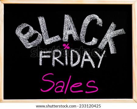Black Friday sales advertisement handwritten with chalk on wooden frame blackboard, Black Friday sale concept - stock photo