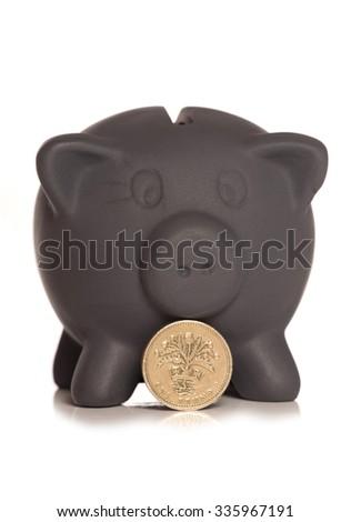 Black friday savings piggy bank  and pound coin cutout - stock photo