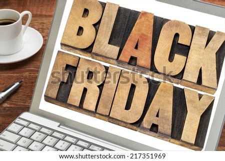 Black Friday - text in vintage letterpress wood type on a laptop.  - stock photo