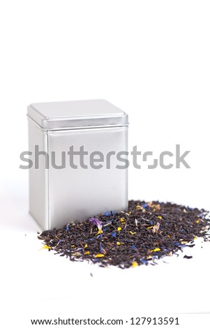 Black fruit tea spilling out of a tea box - stock photo