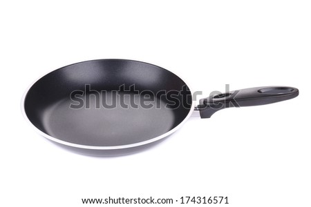 black frying pan. Isolated on a white background - stock photo