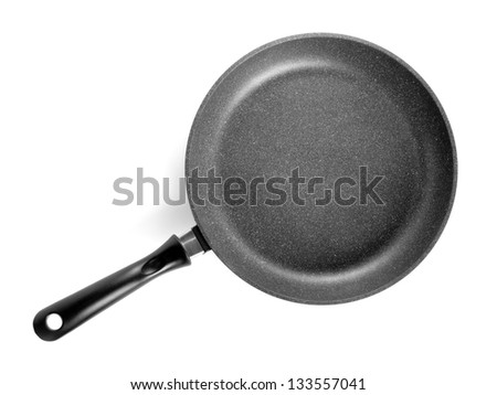 Black frying pan isolated on white background. - stock photo