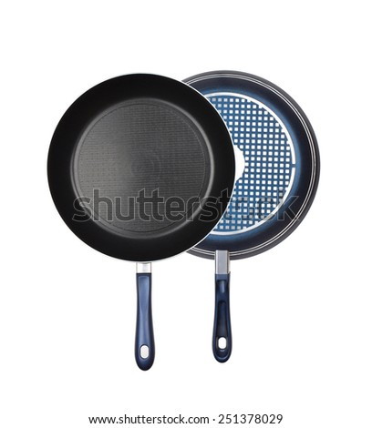 black frying pans isolated on white background - stock photo