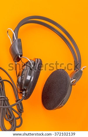 Black Gaming Stereo Headphones on an orange background