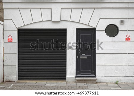 Black Garage and Entrance Door at House