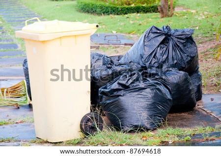 black garbage bag and bin - stock photo