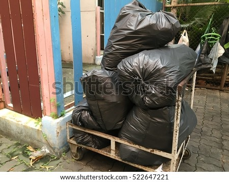 Black garbage bags on a cart