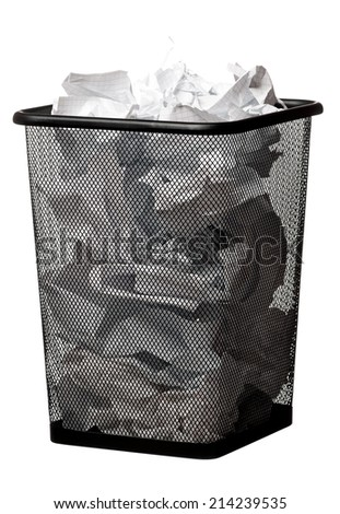 Black garbage bin with paper waste, isolated on white background - stock photo