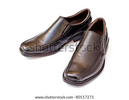 black genuine leather businessmen's shoes on white - stock photo