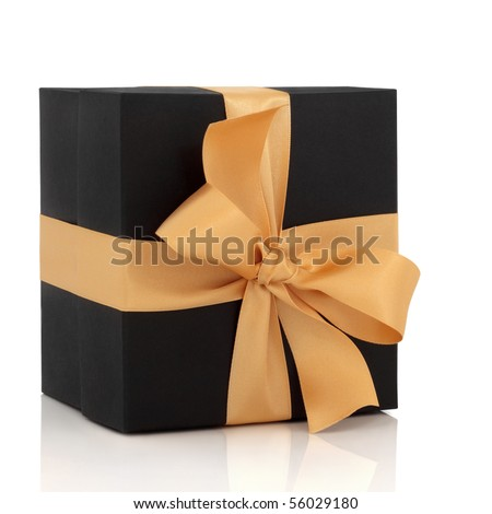 Black gift box with gold satin ribbon and large bow, isolated over white background with reflection. - stock photo