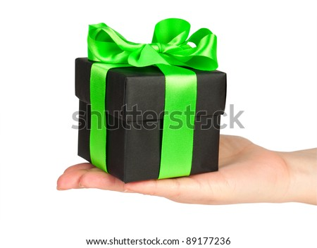black gift box with green ribbon in hand isolated on white - stock photo