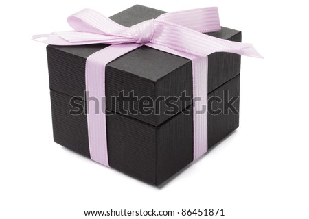 Black gift box with pink bow ribbon on white background - stock photo