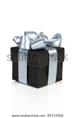 black gift box with silver ribbon isolated on white - stock photo