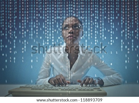 Black girl coding on the computer - stock photo