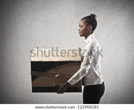 Black girl holding a box - stock photo