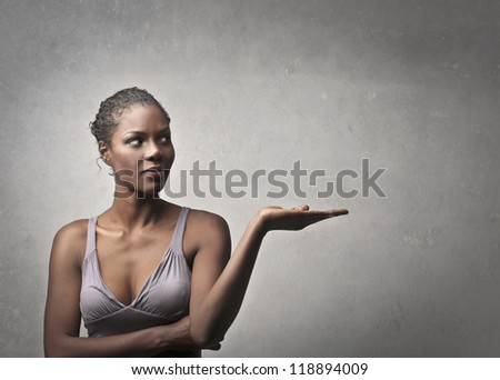 Black Girl mimicking to hold something - stock photo
