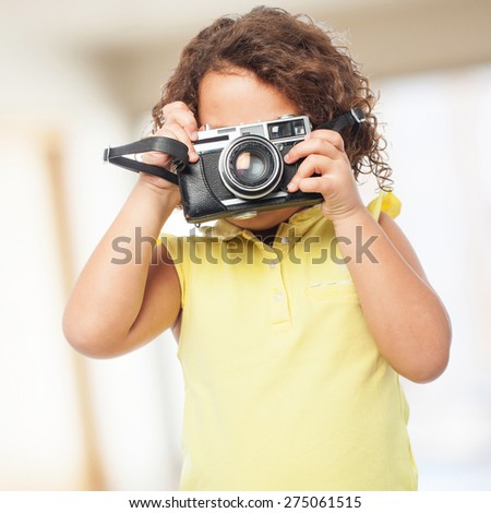 black girl with a camera - stock photo