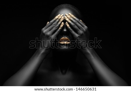black girl with golden lips and the gold on the tips of the fingers .. - stock photo
