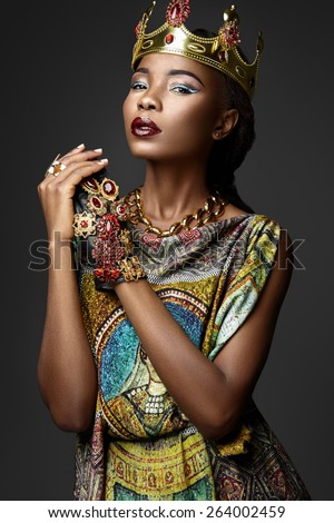 Black girl with jewels on a gray background - stock photo