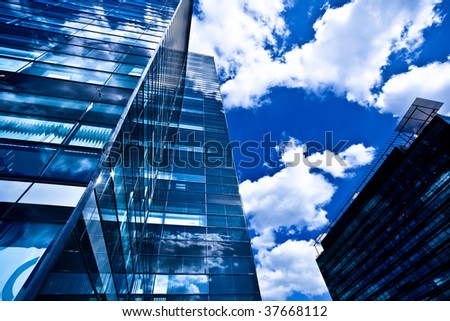 Black glass building against blue sky - stock photo