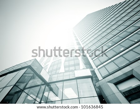 Black glass texture of nigh skyscraper in business center - stock photo
